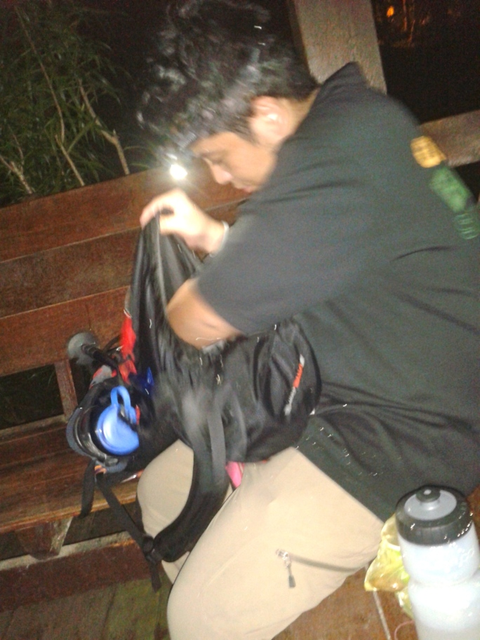 Riz packing his pack for the climb