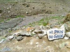 On the way to base camp, the sign reminds one to put in dedication and effort.